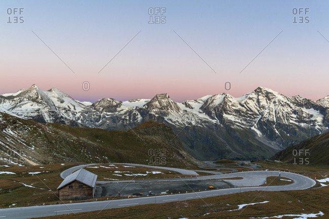 View of the Grossglockner High Alpine Road and the Glockner Group with Sonnenwelleck and Hohe Dock at sunrise, Hohe Tauern National Park, Austria
