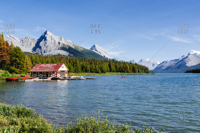 Canada - August 21, 2019: Maligne Lake Boat House with canoa and blue sky, Jasper National Park, Alberta, Canada
