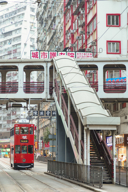 China - October 12, 2019: Footbridge and tram, North Point, Hong Kong Island, Hong Kong