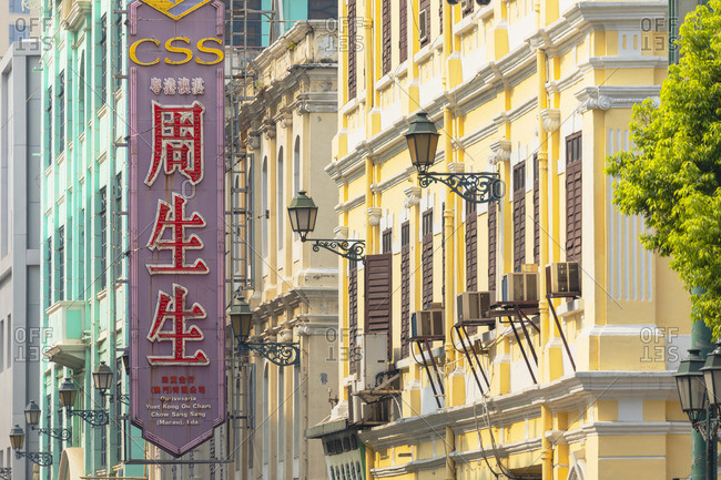 China - September 29, 2019: Chinese sign and colonial buildings, Macau, China