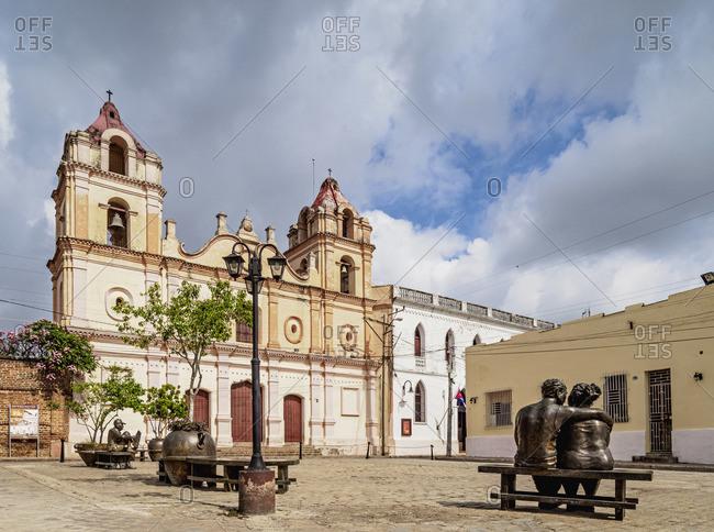 Cuba - April 14, 2019: Martha Jimenez Perez Sculptures and Nuestra Senora del Carmen Church, Plaza del Carmen, Camaguey, Camaguey Province, Cuba
