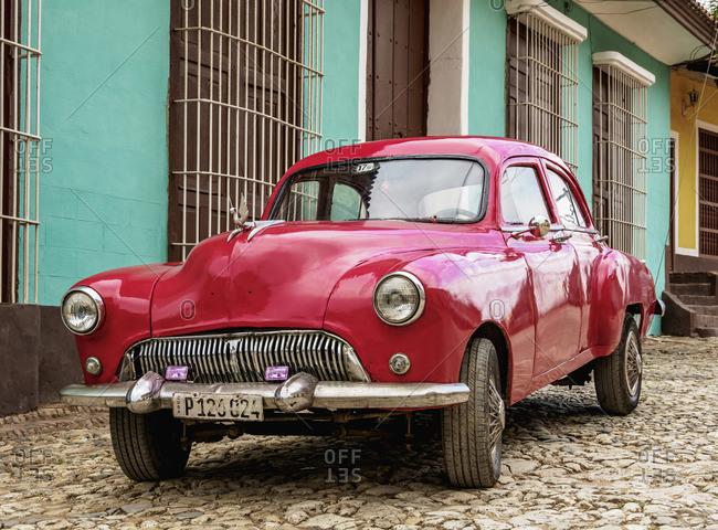 Cuba - April 12, 2019: Vintage car on a cobbled street of Trinidad, Sancti Spiritus Province, Cuba
