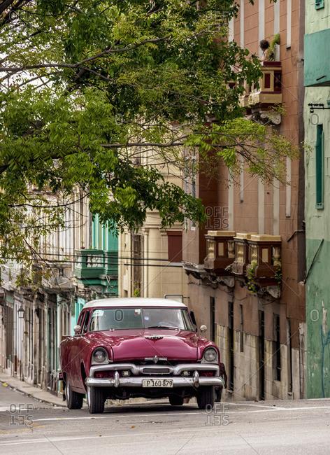 Cuba - May 1, 2019: Vintage car at Neptuno Street, Centro Habana, Havana, La Habana Province, Cuba