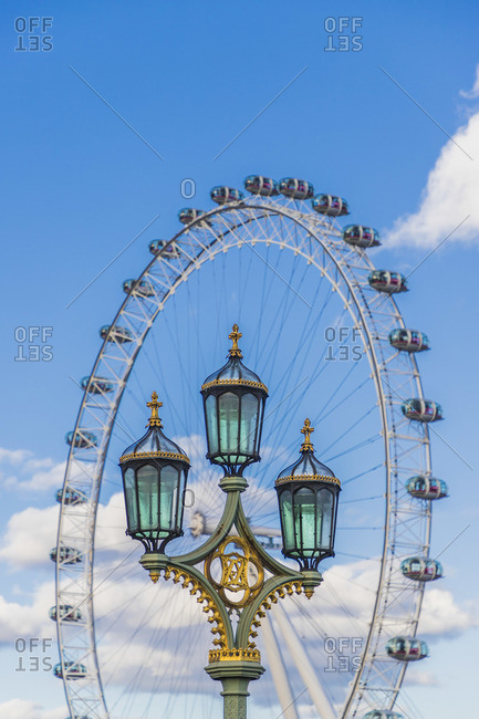 England - March 1, 2020: Street lantern and The London Eye, or the Millennium Wheel, London, England