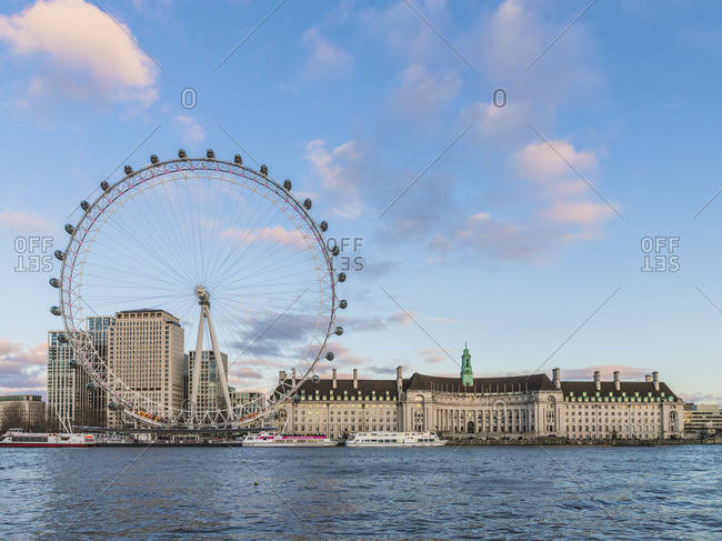 England - March 1, 2020: The London Eye or the Millennium Wheel and County Hall London, England
