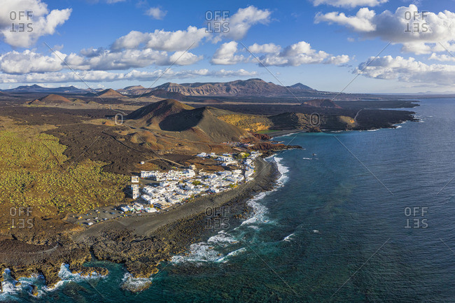 Spain, Canary Islands, Lanzarote, aerial view of El Golfo village and  the volcanic landscape of Timanfaya National Park and the Volcanos Natural Park