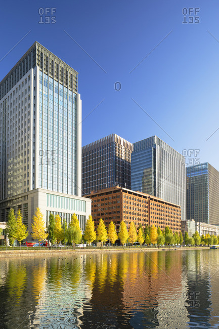 Japan - November 15, 2019: Skyscrapers of Marunouchi and Imperial Palace moat, Tokyo, Japan