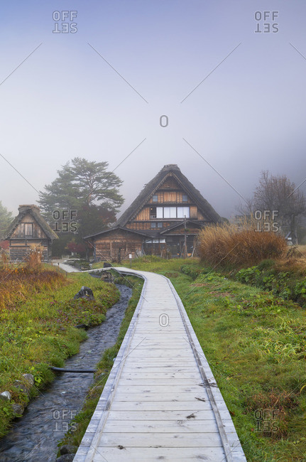 Traditional houses of Ogimachi (UNESCO World Heritage Site) in mist, Shirakawa-go, Toyama Prefecture, Japan