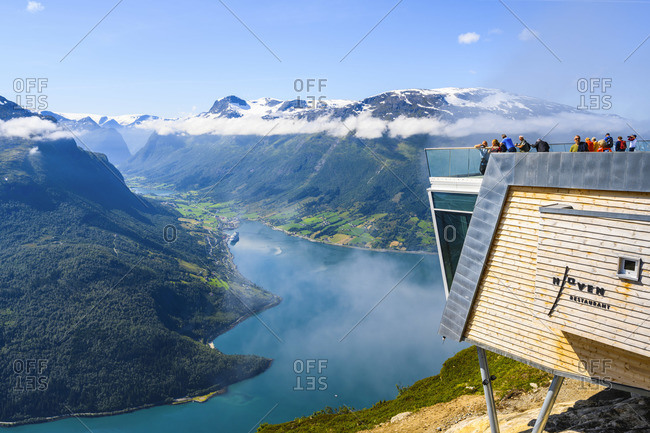Norway - July 10, 2019: Loen, Vestland, Norway. Tourists admiring the view of the Nordfjord fjord from the Hoven restaurant.