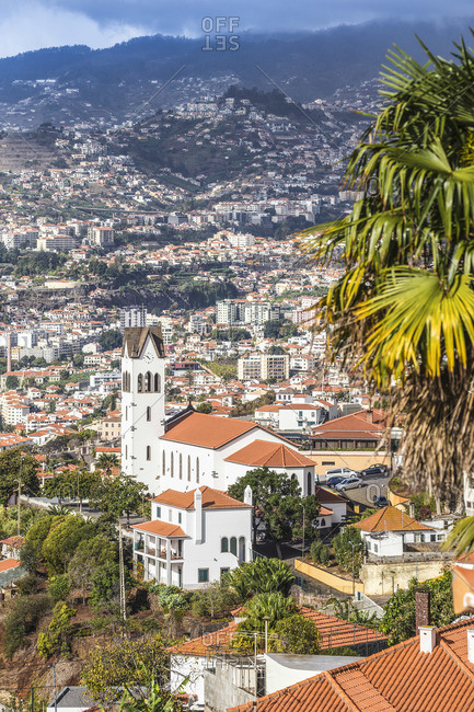 Portugal, Madeira, Funchal, View of Sao Goncalo Church overlooking Funchal harbor and town