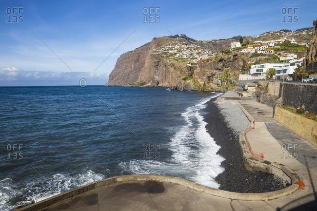 Portugal - November 22, 2019: Portugal, Madeira, Funchal, Camera de Lobos, looking towards the cliffs of Cabo Girah