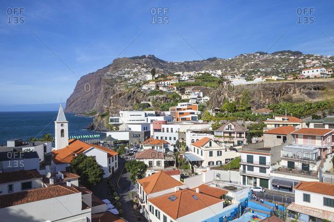 Portugal - November 22, 2019: Portugal, Madeira, Funchal, Camera de Lobos, looking towards San Sebastian Church and the cliffs of Cabo Girah