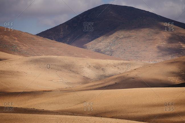 Fuerteventura inland, desertic and volcanic landscape. Canary Islands. Spain
