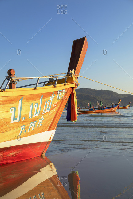 Thailand - January 25, 2020: Long tail boats on Kata Beach, Phuket, Thailand