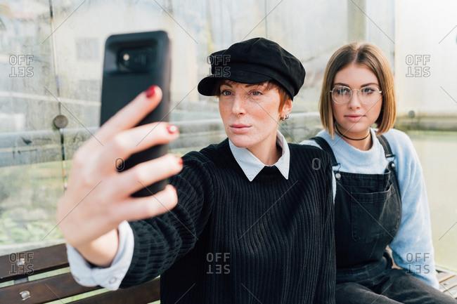 Friends taking selfie together outside
