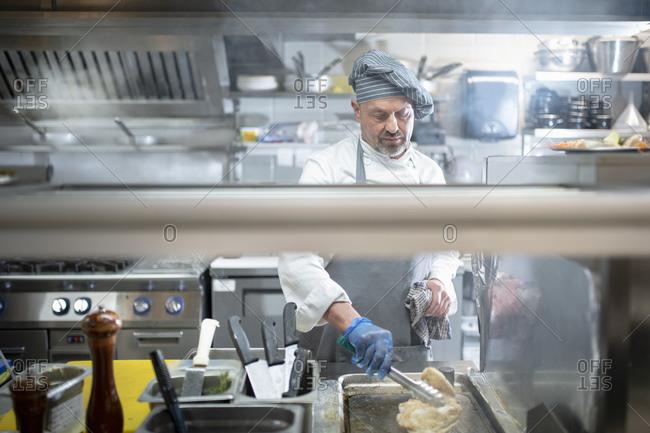 Chef cooking in Italian restaurant kitchen