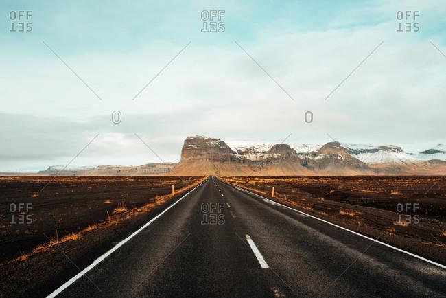 Road leading towards mountain ranges, Kalfafell, Vestur-Skaftafellssysla, Iceland
