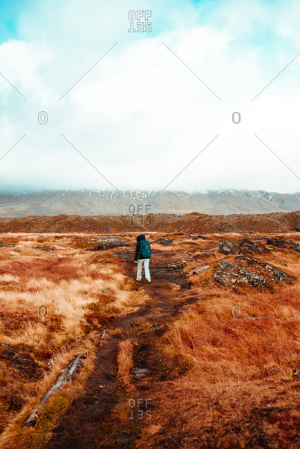 Tourist walking on autumn landscape, Londrangar, Snaefellnes Westfjords, Iceland