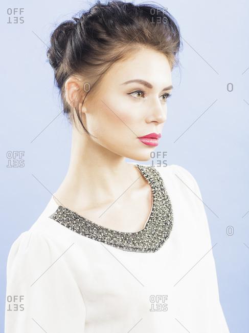 Beautiful young woman looking away, studio portrait