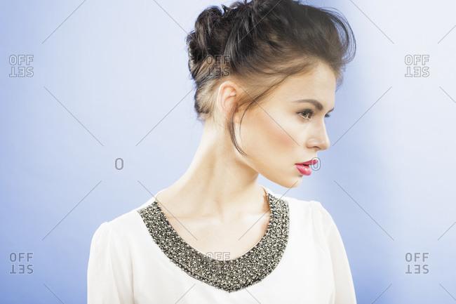 Beautiful young woman, studio profile portrait