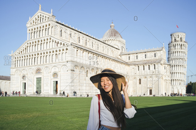 Woman posing in front of Pisa Cathedral, Pisa, Toscana, Italy