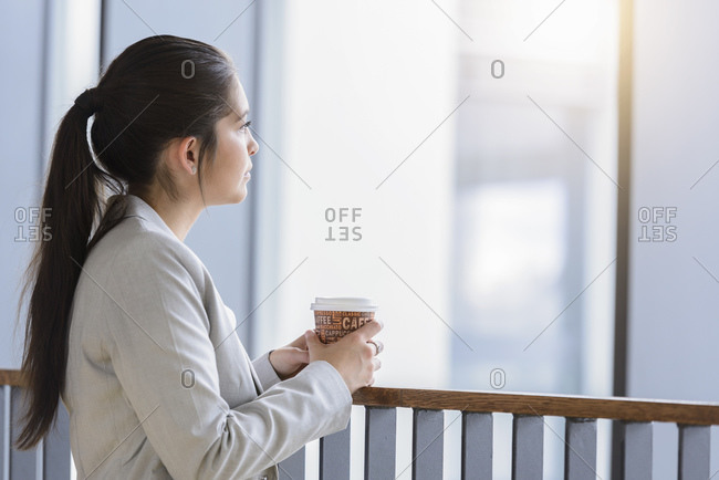 Businesswoman in deep thought at coffee break