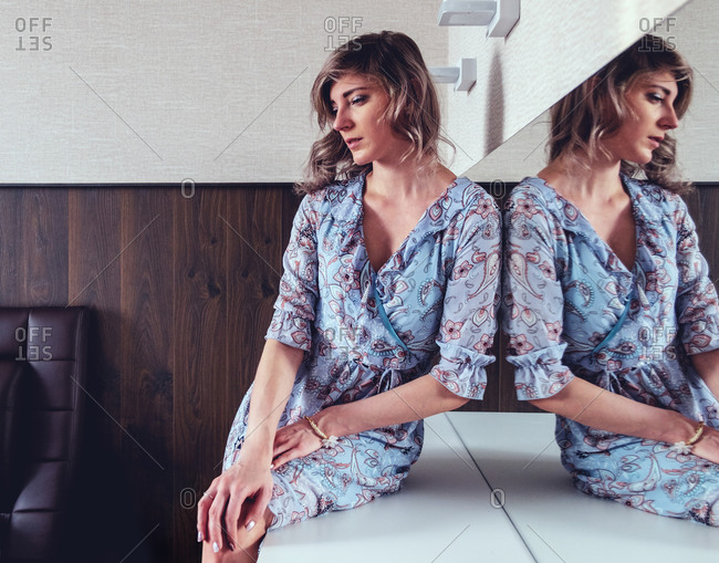 Woman daydreaming on dressing table
