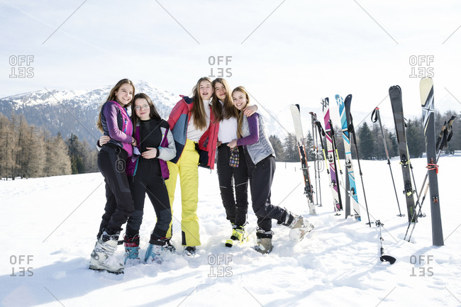 Five teenage girl skiers in snow covered landscape, portrait, Tyrol, Styria, Austria