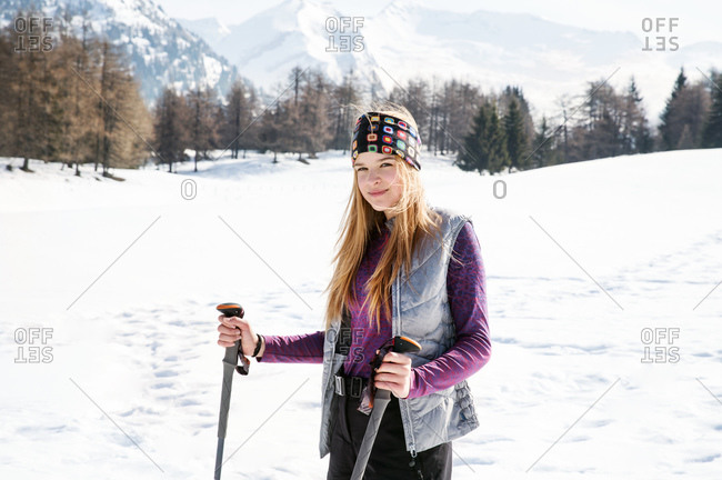 Teenage girl skier in snow covered landscape, portrait, Tyrol, Styria, Austria