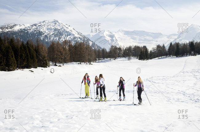 Five teenage girl skiers skiing on snow covered landscape, Tyrol, Styria, Austria