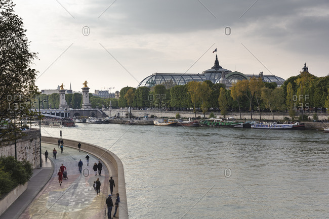 April 14, 2019: Scenic view of Grand Palais and Pont Alexandre III over river Seine, Paris, France