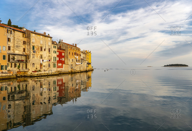 Scenic view of Rovinj old town reflected in sea at dawn, Istria Peninsula, Croatia