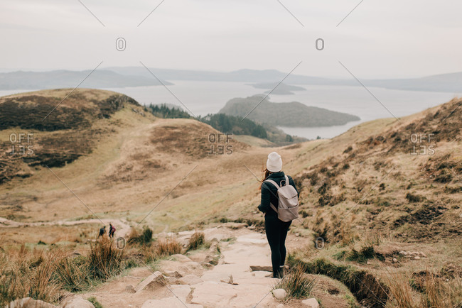 Trekker enjoying view of Loch Lomond, Trossachs National Park, Canada