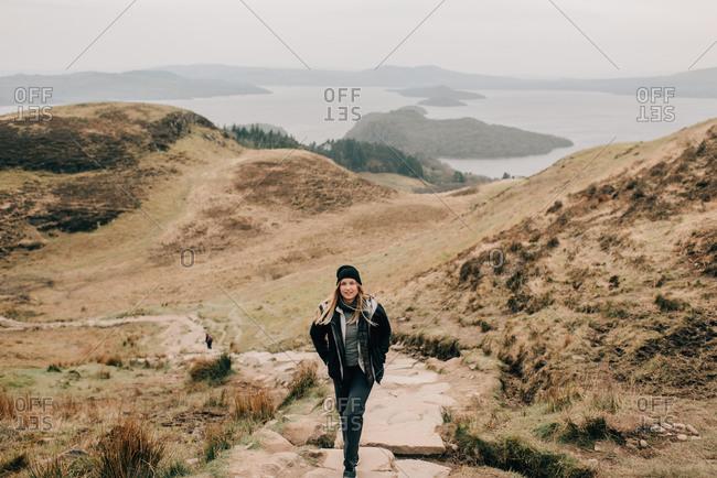 Trekker, Loch Lomond in background, Trossachs National Park, Canada