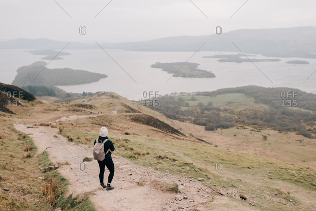 Trekker enjoying view of Loch Lomond, Trossachs National Park, Canada