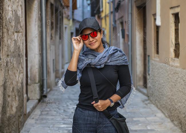 Woman on cobblestone street, Rovinj, Croatia