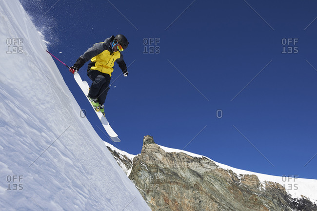 Skier moving down slopes, Saas-Fee, Valais, Switzerland