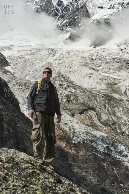 Hiker enjoying walk, Saas-Fee, Valais, Switzerland