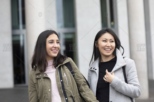 Friends waiting in front of building