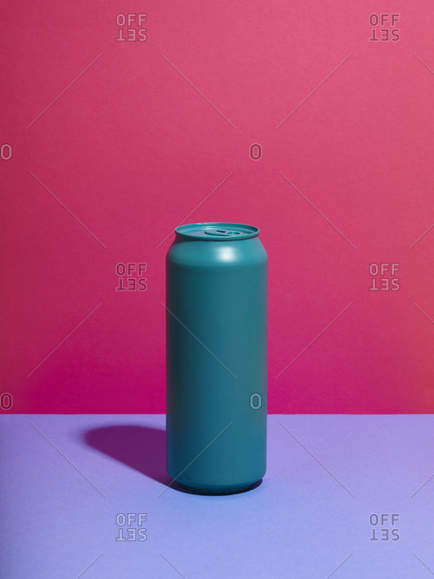 Still life of turquoise drink can and pink background