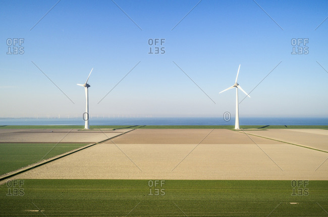 Coastal wind turbines and field landscape in spring, elevated view, Urk, Flevoland, Netherlands
