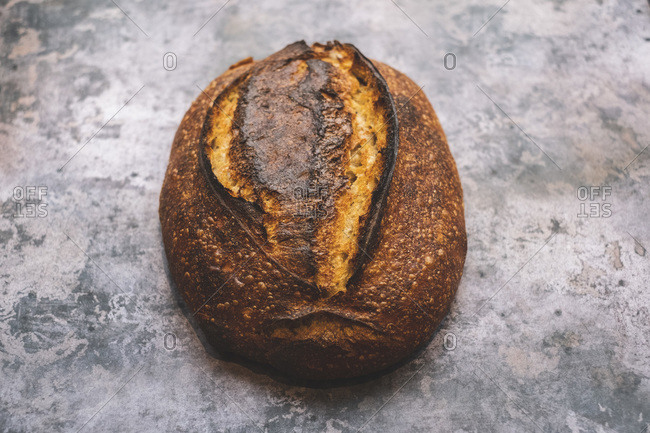 Country loaf, a baked sourdough loaf with a dark crust.