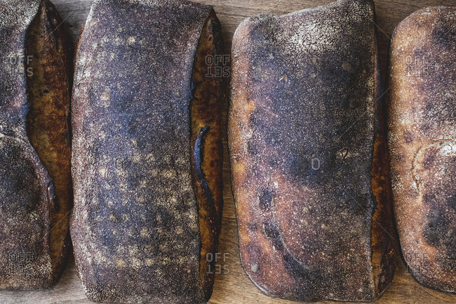 Baked sourdough bread loaves with a dark crust.