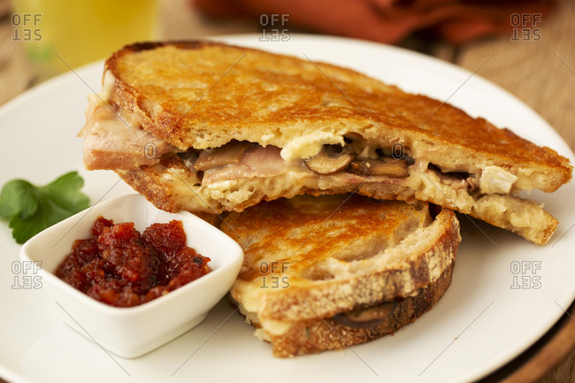 Close up of toasted sourdough mushroom melt with chutney in a cafe.