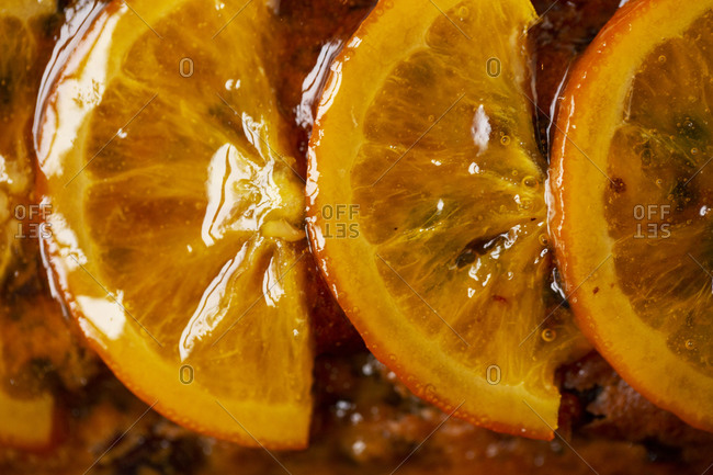 High angle close up of slices of candied orange.