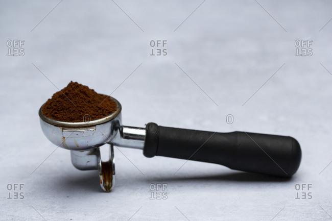 High angle close up of espresso machine portafilter.