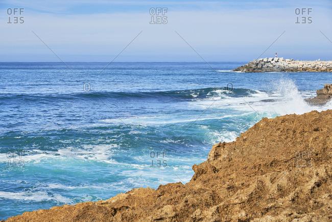 Waves crashing on the rocky coast near Ericeira, Lisbon region, Portugal