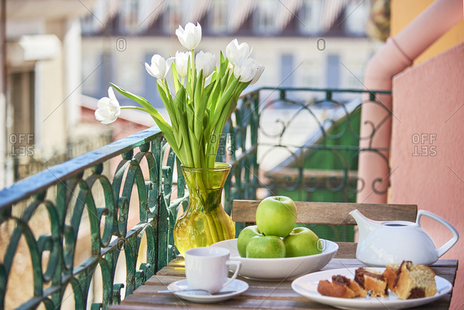 Green apples and tea on balcony on a building in Lisbon, Portugal