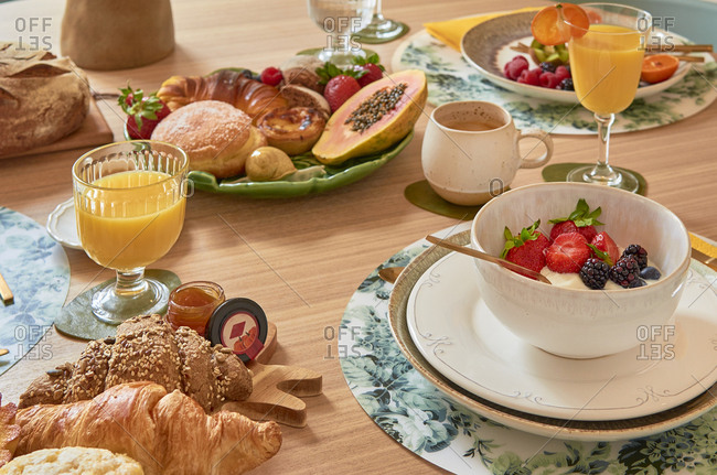 Portuguese breakfast with fruit and pastries on a wooden table