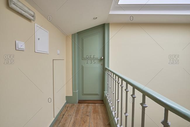Green apartment door inside building in Lisbon, Portugal